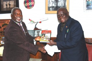 "President Kaunda receives a copy of the book: ""Satisfying Zambian Hunger fro Culture"" from Professor Tembo in November 2012."