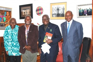 "After President Kaunda received the book: ""Satisfying Zambian Hunger for Culture"". From right to left: The author's late Uncle Mr. J. J. Mayovu, President Kaunda, Professor Tembo, and Mr. Mfula."