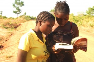 "Two girls browsing the only copy  the author had of the book: ""Satisfying Zambian Hunger for Culture"". This was in November 2012 at Chikana Village in Chief Magodi's area  West of Lundazi."
