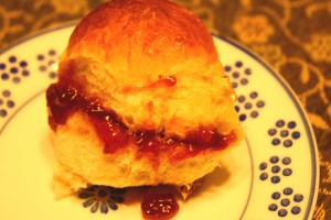 Scone or bun with sweet jam.