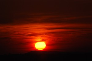 Compose a poem about sunrises in Zambia using a Zambian language.