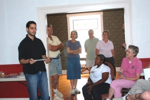Town residents of Bridgewater gather and listen to a campaign organizer in the Bridgewater town campaign office.