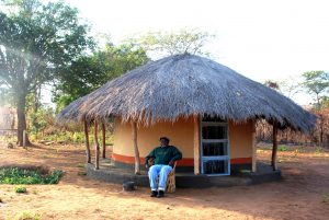Author in front of his hut in the village in Lundazi District in Eastern Zambia.